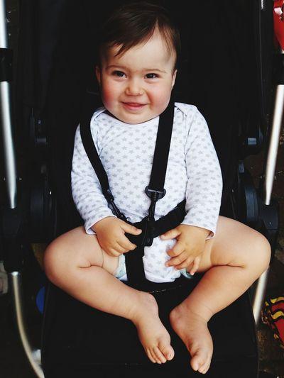 Portrait Of Cute Boy Baby Sitting On Seat