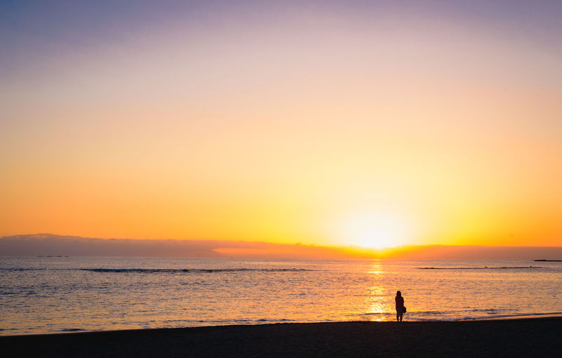 Lonely woman standing at the beach watching the sundown Holiday Loneliness Beach Beauty In Nature Evening First Eyeem Photo Horizon Horizon Over Water Land Leisure Activity Mood Nature One Person Outdoors Scenics - Nature Sea Silhouette Sky Standing Sun Sundown Sunset Tranquil Scene Tranquility Water