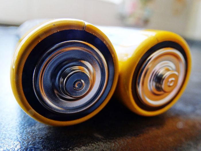 Close-up of batteries on table