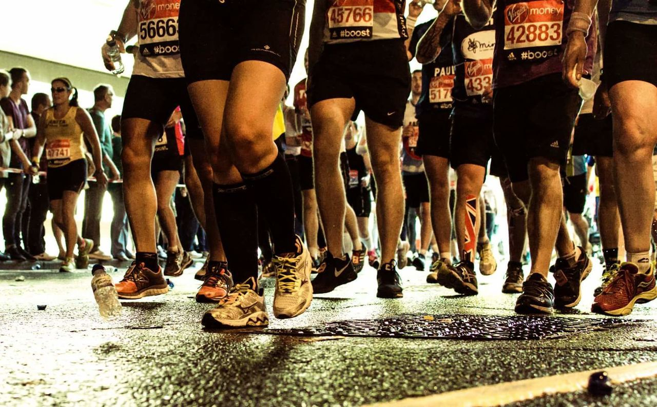 low section, large group of people, human leg, real people, men, competition, motion, day, outdoors, people, adult