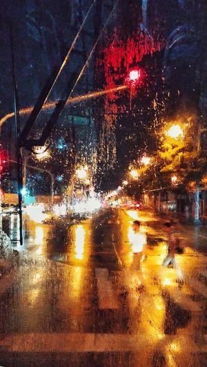 Wet glass window in rainy season at night