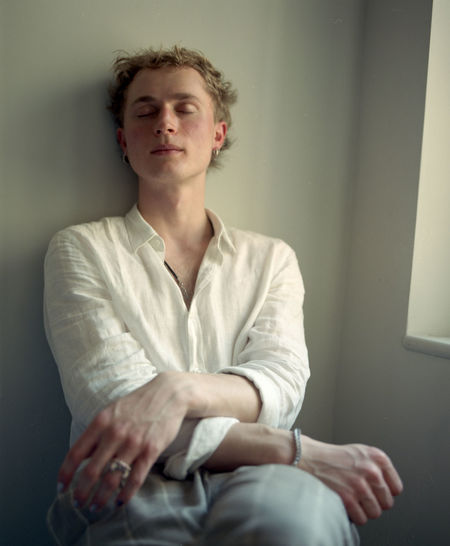 Tristan - 2018 120mm Film Adult Blond Hair Business Person Chair Contemplation Day Film Photography Filmisnotdead Front View Hair Hairstyle Hands Clasped Indoors  Looking One Person Portrait Relaxation Sitting Three Quarter Length Young Adult Young Men The Portraitist - 2018 EyeEm Awards