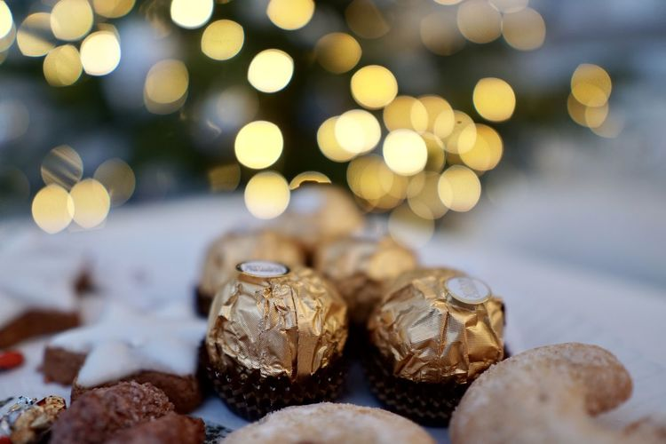 Temptation Sweet Gold Colored Unhealthy Eating Celebration Christmas Illuminated Holiday Sweet Food Lens Flare Baked Focus On Foreground Freshness Indoors  Food Food And Drink Still Life Table Selective Focus No People Close-up Finance Indoors  Nature Rock Solid Large Group Of Objects