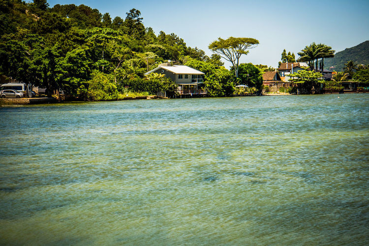 Lagoa Da Conceição Architecture Beauty In Nature Building Exterior Built Structure Day Florianópolis Brasil House Nature No People Outdoors Palm Tree Sky Tree Water Waterfront