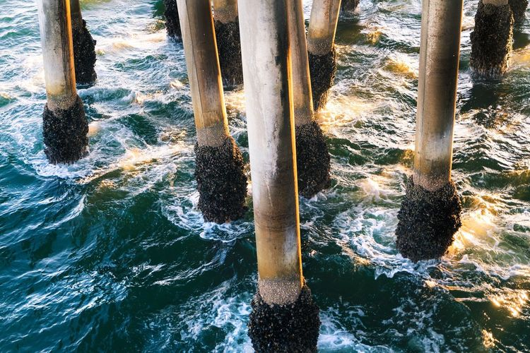 Motion Water Nature No People Waterfront Beauty In Nature Day Outdoors High Angle View Rock - Object Sunlight Scenics Sea Waterfall Wave Fishing Pier Pylons Sea Blue California Beauty In Nature