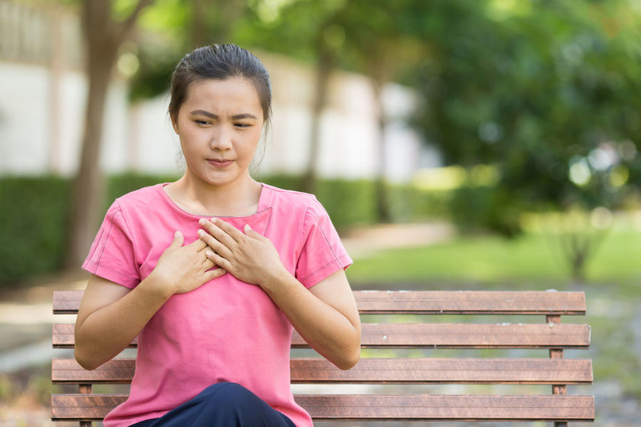 Woman has reflux acids in the garden Acid Breathing Care Diet Emergency Green Nature Pain Pink SORE Woman Chest Garden Health Heart Heartburn Ill Illness Problem Reflux Relax Sick Sickness Unhealthy Unwell