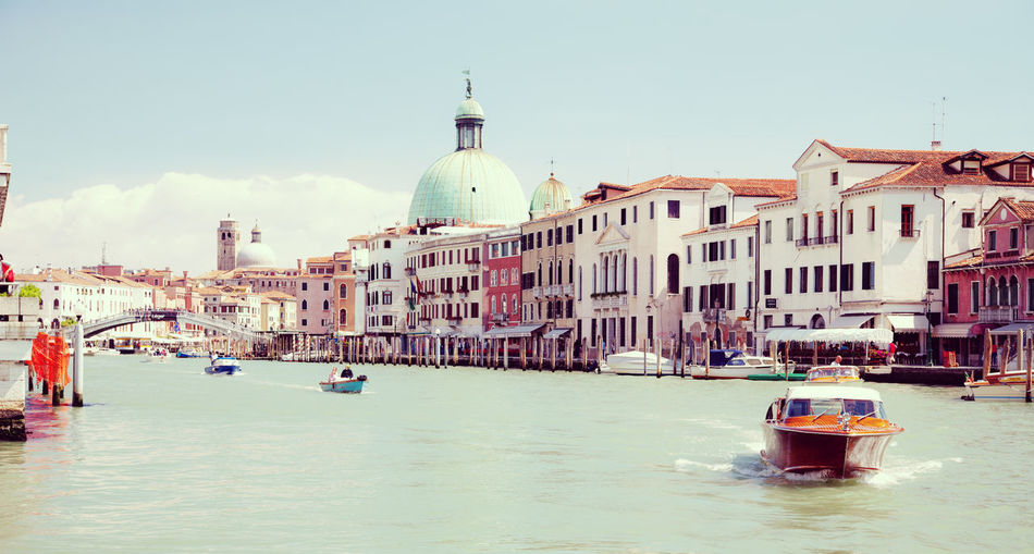 Grand canal by buildings against sky in city
