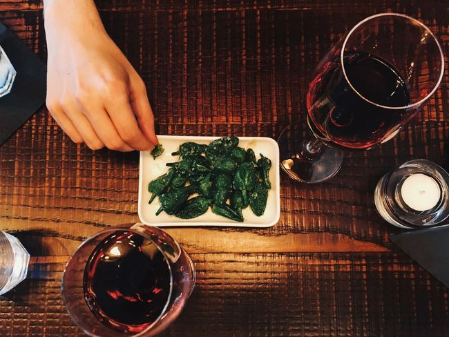 Wine Moments Wine Food And Drink Table Food One Person Indoors  Plate Freshness Real People Human Hand Ready-to-eat Healthy Eating Wine Not Padron Peppers Red Wine High Angle View View From Above Wooden Lifestyles Lifestyle Green IPhoneography Tapas Spanish Food