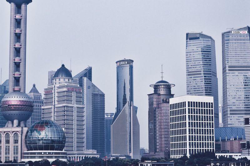 Oriental Pearl Tower Against Modern Buildings In City
