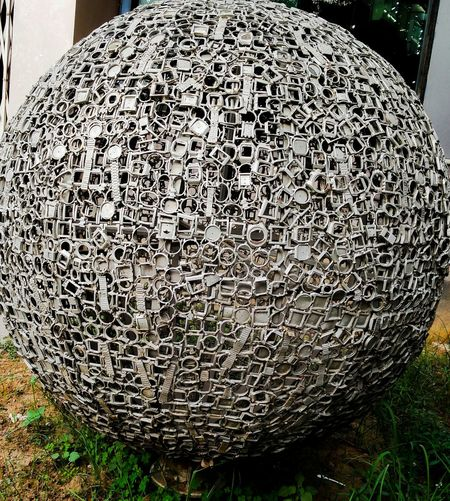 This sculpture is an assemble of 4500 watch parts weighing 200kgs anf globing 42 inches if diameter . Sculpture Watches Globe Decolorizer Oneplusphotograpgy Oneplustwocamera
