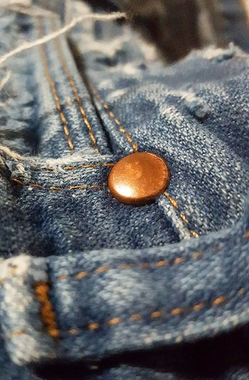 Brass rivet on jeans Blue Jeans Close-up Day Frayed Fabric Indoors  Mens Denim Jeans No People Old