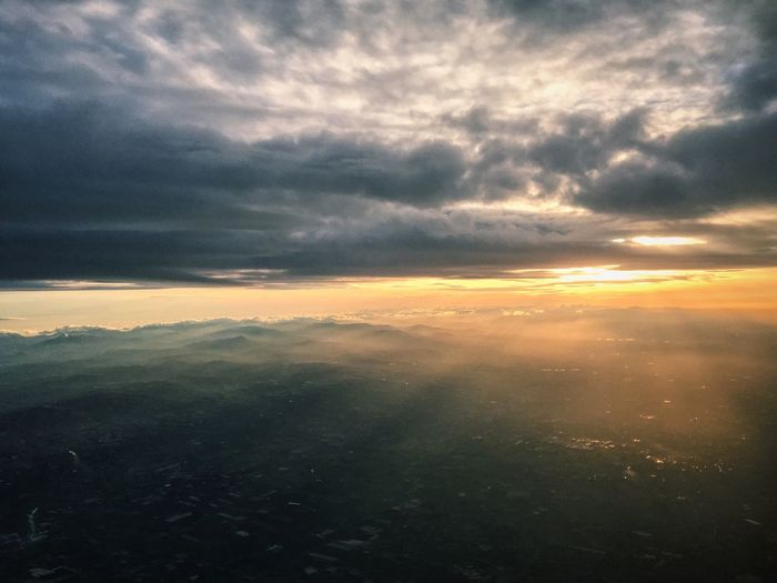 A Bird's Eye View the view from Britishairways . Direction: London ☑️ Sunset Scenics Beauty In Nature Cloud - Sky Cloudscape Tranquil Scene Tranquility Idyllic Majestic Aerial View Nature Sky Cloudy Cloud Atmospheric Mood Calm Outdoors Cumulus Mountain Dramatic Sky Airplane