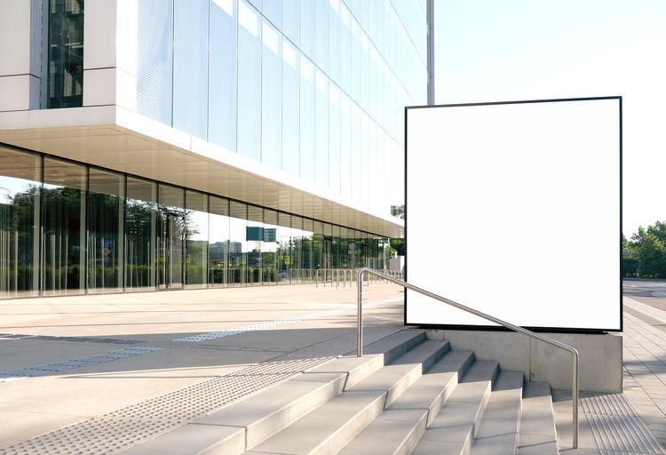 Modern glass building against sky