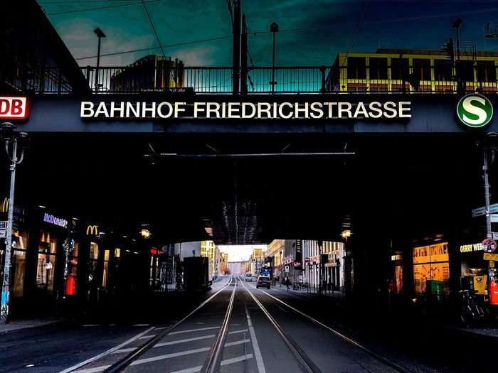 Friedrichstraße in Berlin Train Station Streetphotography Street Photography Berlin Friedrichstrasse Transportation Railroad Track Rail Transportation Text Mode Of Transport Communication Public Transportation Outdoors Night Built Structure Architecture Sky No People City EyeEmNewHere