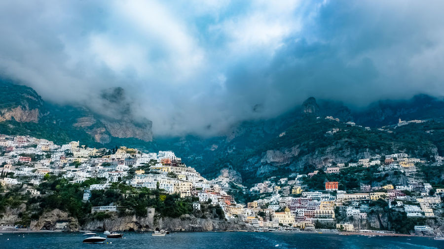 Positano view from the ocean, on the way to Capri, Amalfi coast, Italy. Architecture Building Exterior Water Built Structure Mountain City Sea Cloud - Sky Sky Nature Building Scenics - Nature Environment Nautical Vessel Travel Destinations Land Cityscape No People Outdoors Coast Coastline Coastline Landscape Positano, Italy Positano Positanocoast