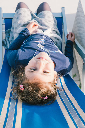 little girl on a chair at sea 6 Years Old Casual Clothing Chair Child Childhood Close-up Day Elementary Age Front View Girls Happiness High Angle View Leisure Activity Lifestyles Little Girl Looking Up Lying On Back One Person Outdoors Portrait Real People Sea Smiling The Portraitist - 2017 EyeEm Awards
