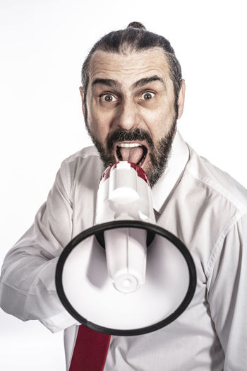 Megaphone Businessman Business Man Announcement Speaker Communication Loud Male Background Shouting Suit People Adult Isolated Holding Sound White person Announce Executive  Message Yelling Young Noise Speaking Shout Success Fun Communicate Loudspeaker Finance Caucasian