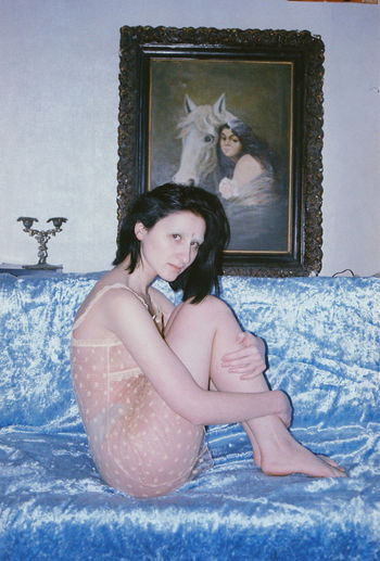 One Person Women Real People Females Looking At Camera Indoors  Portrait Lifestyles Velvet Queer Feminine  Film Film Photography Nude_model Nudity, Colors Sitting Pale Blue Girl Beauty