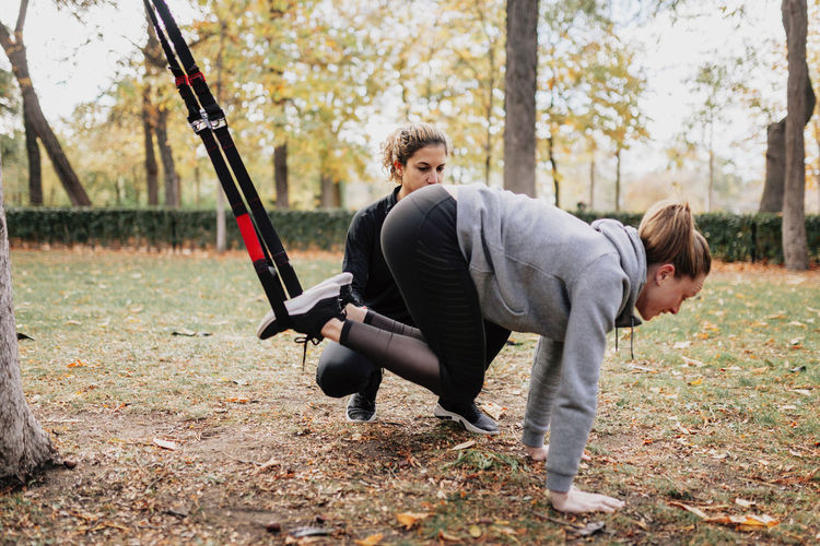 Low angle view of women exercising at park