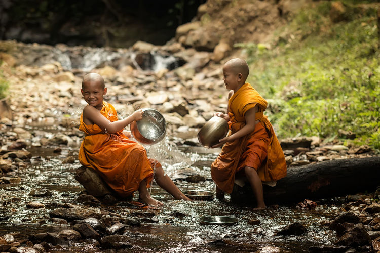 Monks playing in stream
