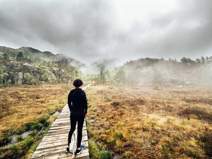 Adult Beauty In Nature Boardwalk Cloud - Sky Day Epic Fog Full Length Hike Holiday Mountain Nature Norway One Man Only One Person Outdoors People Rear View Scandinavia Scenics Sky