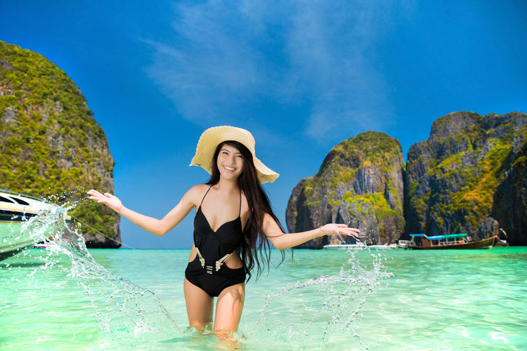 Adult Beautiful Woman Beauty In Nature Bikini Clothing Day Hat Leisure Activity Lifestyles Nature One Person Real People Rock Sea Sun Hat Swimwear Three Quarter Length Water Waterfront Young Adult Young Women