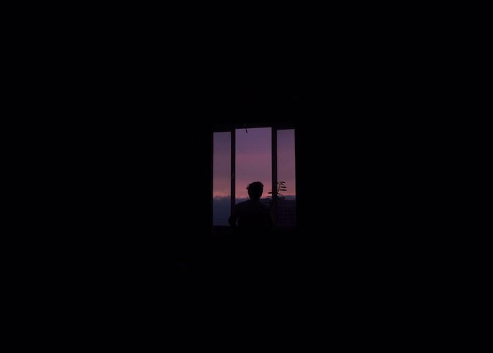 Silhouette of man in dark room