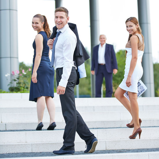 Portrait Of Business People Standing On Steps