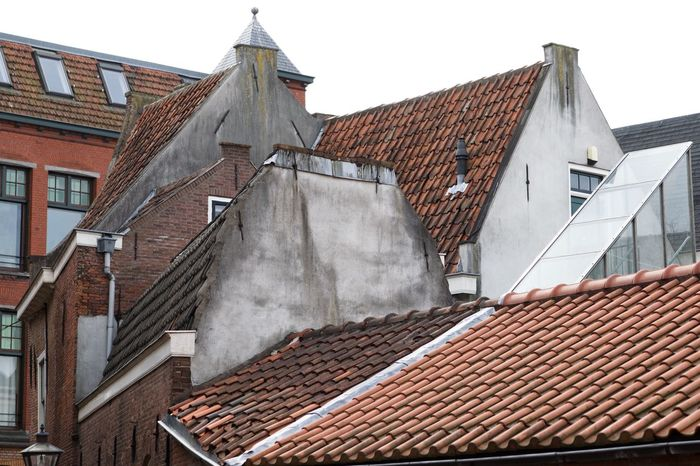 Architecture Building Exterior Built Structure Chimney Day Holland House Leiden No People Outdoors Red Roof Roof Tile Shapes Sky Tiled Roof