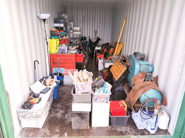 High angle view of various toys in container