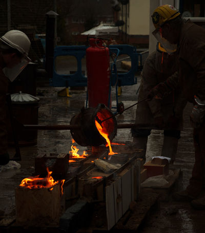 Art And Craft Art College Art Student Fire Heat - Temperature Iron Pour Men Metal Industry Molten Occupation Protective Workwear Real People Sculpture Women Working