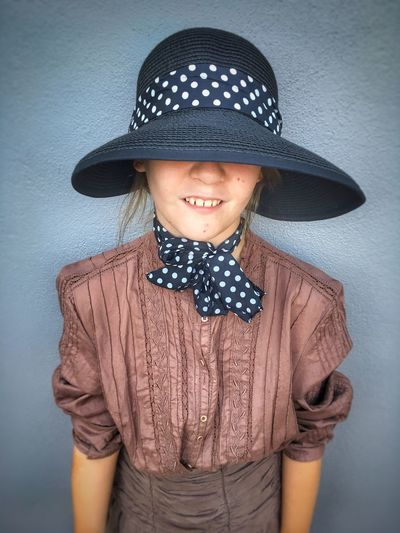Moody girl wearing a hat. Hat Portrait Polka Dot Waist Up Looking At Camera Child Girl Fashion Childhood Standing Human Face One Person People Teeth Moody Grey The Week On EyeEm Attitude Mix Yourself A Good Time