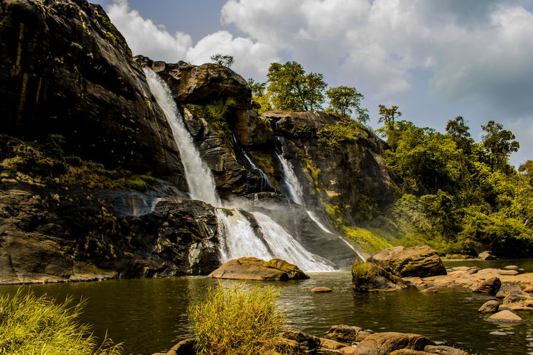 Summer falls Water Waterfall Tree River Nature Cloud - Sky Motion Beauty In Nature No People Outdoors Scenics Forest Sky Day Vacations Freshness Kerala India Kerala The Gods Own Country ;) Athirappilly Falls Summer Exploratorium Summer Exploratorium