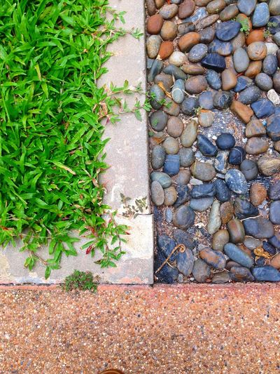 Footpath Grass Gravel High Angle View Nature No People Outdoors Paving Stone Pebble Stone - Object Stone Material