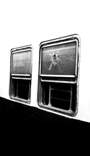 Outdoors No People Bnw_collection Monochrome Blackandwhite EyeEm Best Shots Bestsellers 2017 Oneplusphotograpgy EyeEm Selects Premium Collection The Week On EyeEm Transportation Window Broken Broken Glass Wreck Rampage  Peace Train Damaged War Simplicity Day White Background Black And White