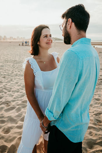 Young couple standing on beach