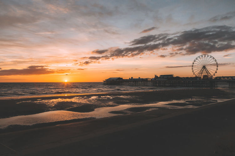 View of blackpool beach at sunset