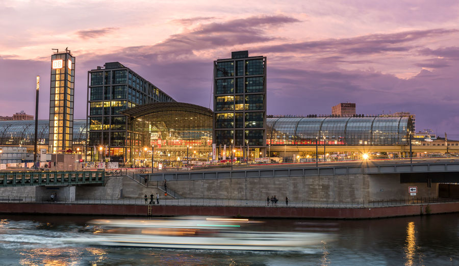 Built Structure Architecture Building Exterior Water Cloud - Sky Illuminated River Sunset Waterfront City Dusk Building Transportation No People Bridge - Man Made Structure Outdoors Skyscraper Modern Cityscape Berlin Hauptbahnhof Station Train Central Central Train Station