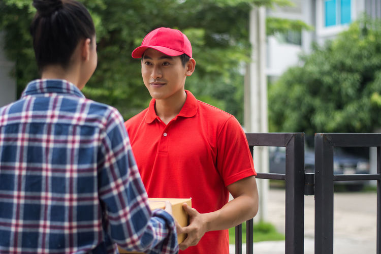 Adult Baseball Cap Boys Cap Casual Clothing Day Focus On Foreground Hat Males  Men Outdoors People Real People Standing Teenage Boys Togetherness Two People Waist Up Young Adult Young Men