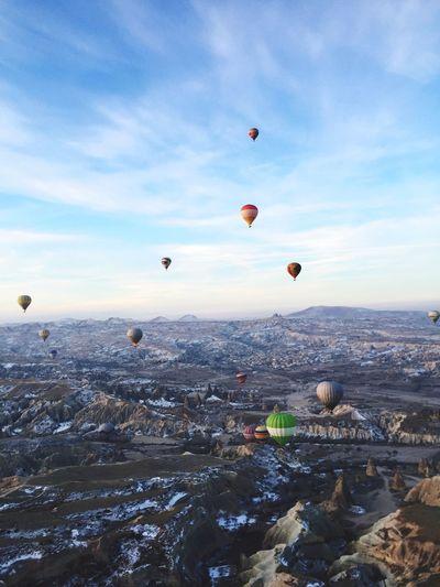Hot Air Balloons Flying Over Cappadocia In Winter