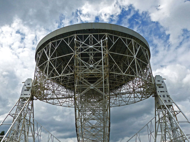 Close up to the Lovell Telescope Architectural Feature Blue Bluedot Built Structure Cloud Cloud - Sky Jodrell Bank Lovelltelescope Low Angle View Observatory Otherworldly Outdoors Overcast Sky Tall - High Travel Destinations Weather