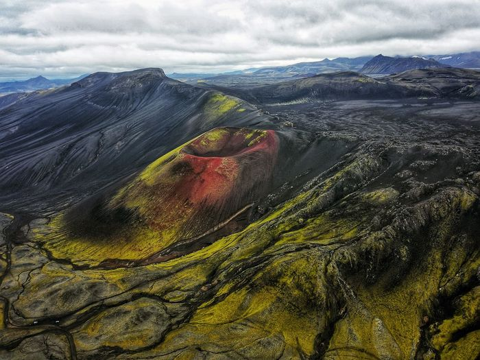 Aerial view of volcanic landscape against sky