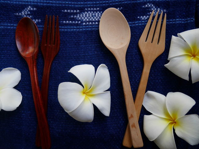 wooden spoons and fork Blackground Eating Plumeria Spoon Art Blue Buautiful Close-up Consept Day Directly Above Flower Flower Head Food Forks Freshness Indoors  No People Spoon And Fork Table Wooden Wooden Spoon And Fork