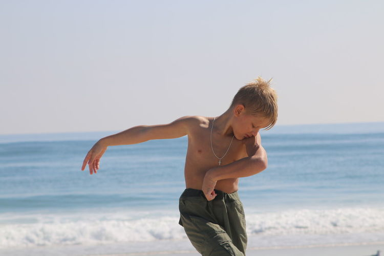 Boy Dancing On Beach