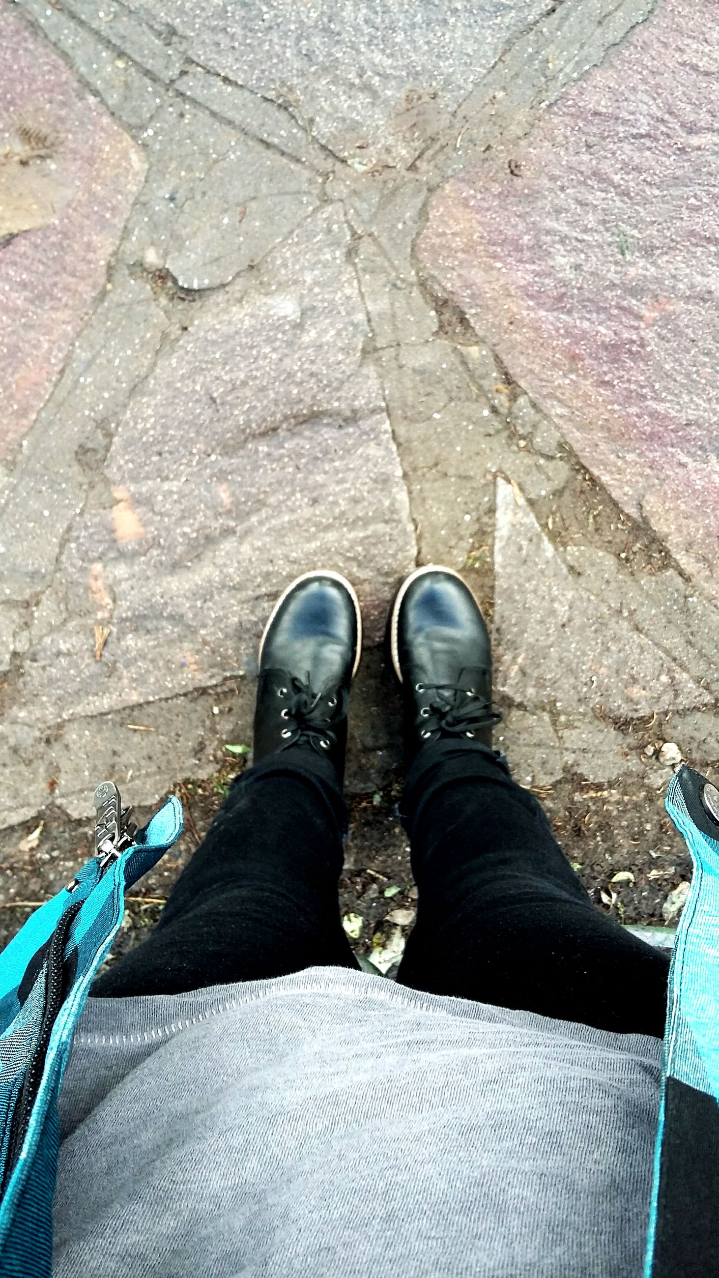 low section, person, shoe, personal perspective, high angle view, human foot, jeans, footwear, standing, cobblestone, directly above, paving stone, lifestyles, men, footpath, street, outdoors