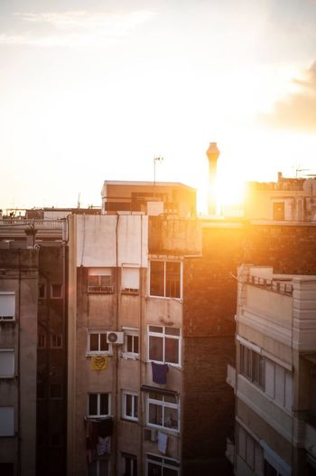 Roof EyeEmNewHere Barcelonaphotographer Barcelona Architecture Sky Building Exterior Built Structure Sunset Building Sunlight Outdoors Cityscape Travel Destinations Construction Industry Transportation Industry Lens Flare