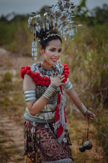 A woman in sea dayak of borne island outfit