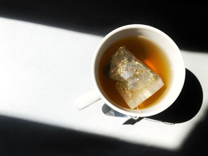 High angle view of tea cup with tea bag on table