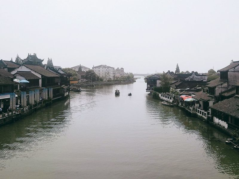 A city of water Gray Boat Riverside River Water Sky Nature Outdoors Day Clear Sky