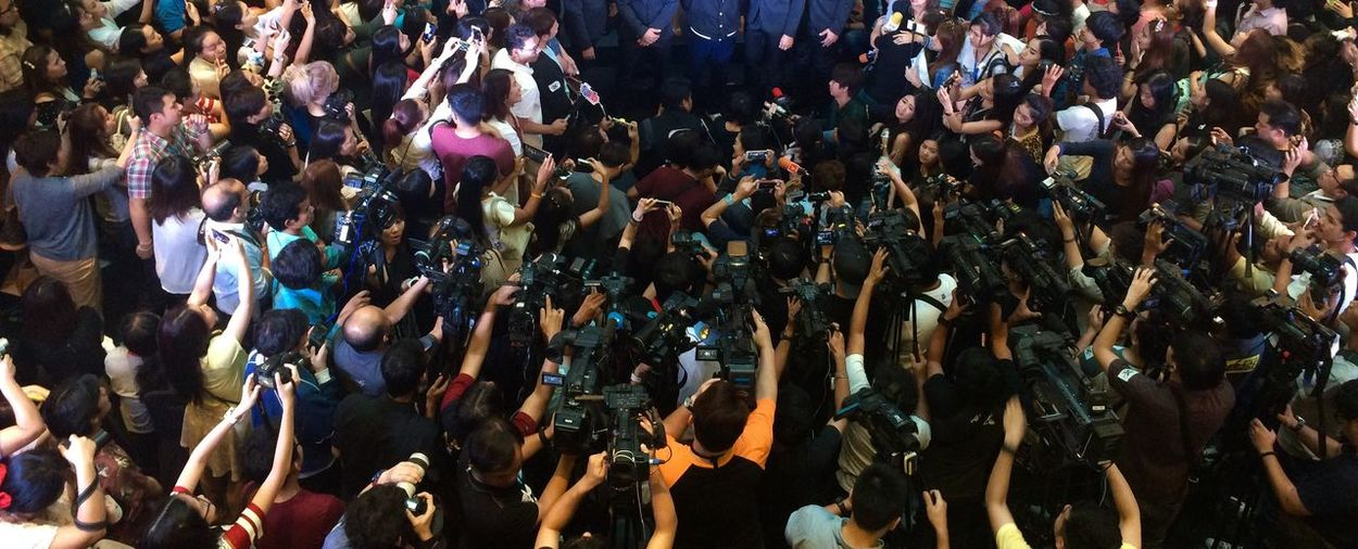 High angle view of crowd during press conference